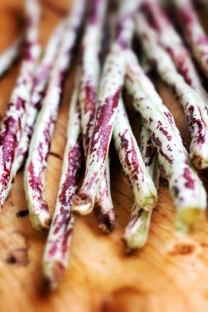 long bean: Purple yard long bean on wood background Stock Photo
