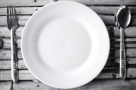 Empty dish and spoon fork Stock Photo