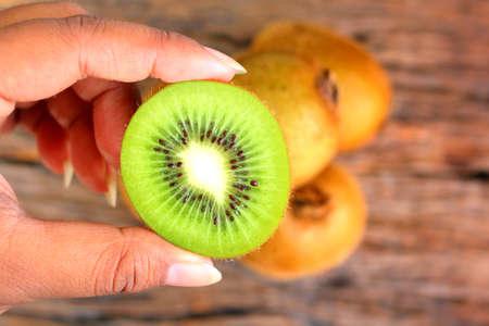 freshest: Kiwi fruit on wood background Stock Photo