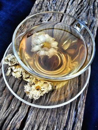 chamomile tea: Chamomile tea on the wood background