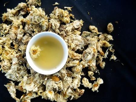 chamomile tea: Chamomile tea on black background