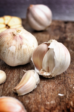 Garlic on the brown wood background Stock Photo - 21904198