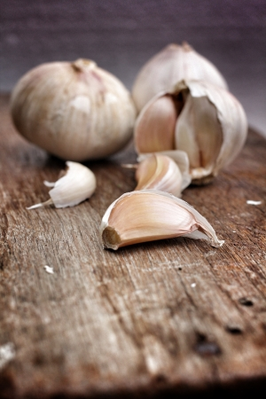 Garlic on the brown wood background Stock Photo - 21904199