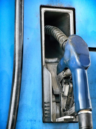 Fuel nozzle at a gas station photo