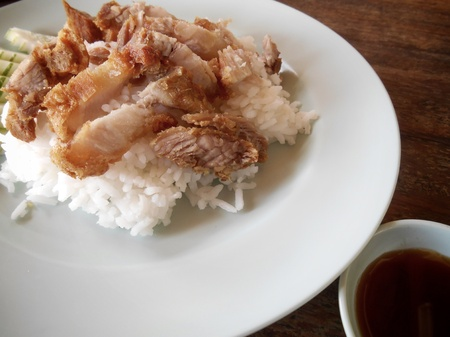 Crispy roasted belly pork chinese style and rice photo
