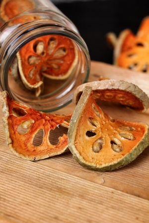 Slices of dried bael fruit photo
