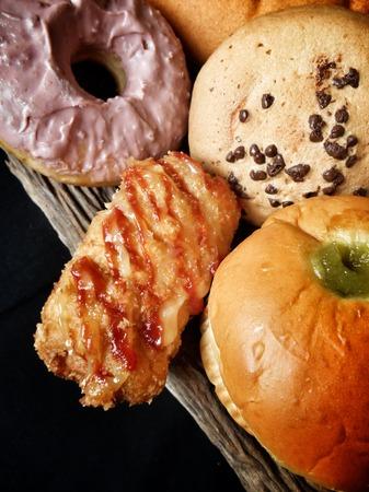 foodstuffs: Bakery foodstuffs set on black background