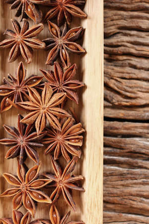 anis: Star anise on wood background Stock Photo