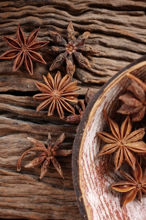 anice: Star anise on wood background Stock Photo