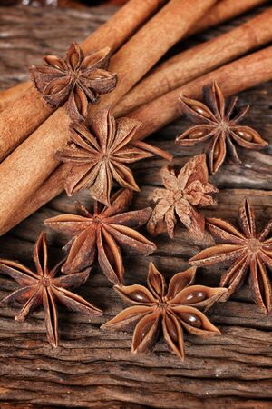 anice: Star anise and cinnamon on wood background