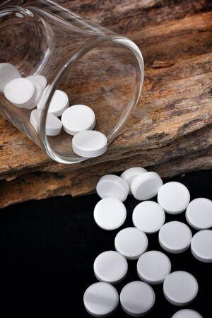 Paracetamol pill on black background photo
