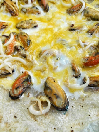 Mussels fried in egg batter photo