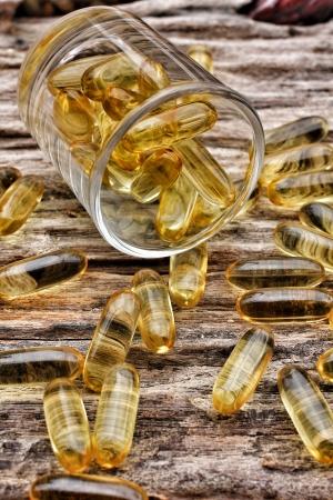 cod oil: Close-up of cod liver oil capsules