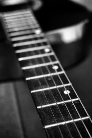 country music: closeup of guitar on black background Stock Photo