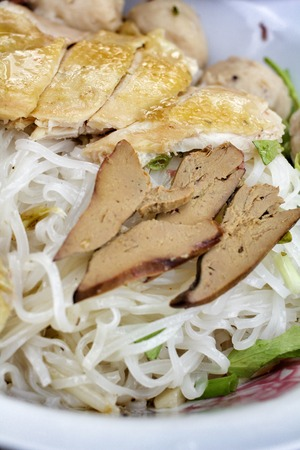 Chicken and noodle in bowl photo