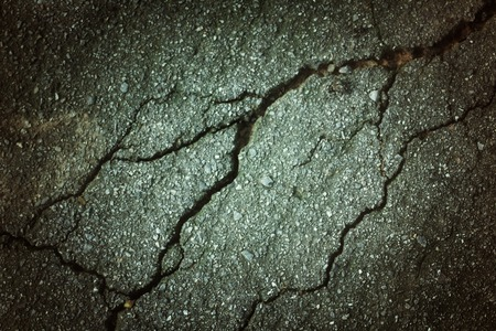 Cracks on the road background photo