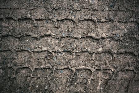Wheel tracks on the soil.