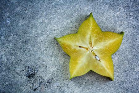 star fruit on gray  Stock Photo