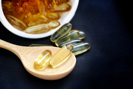 cod oil: Close-up of cod liver oil capsules