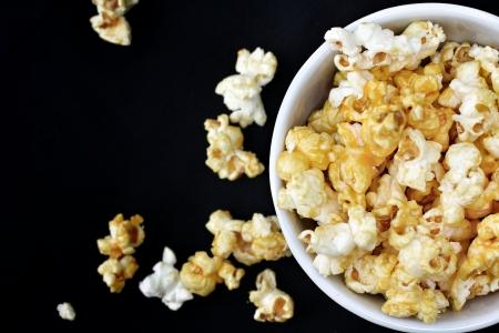 popcorn bowls: popcorn on the black background