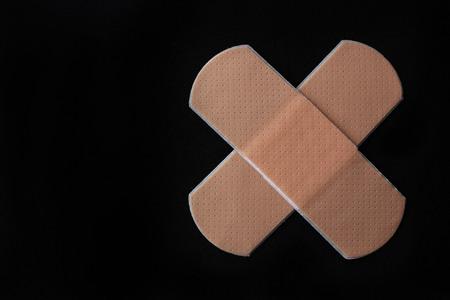 Medical adhesive bandage on black  Imagens