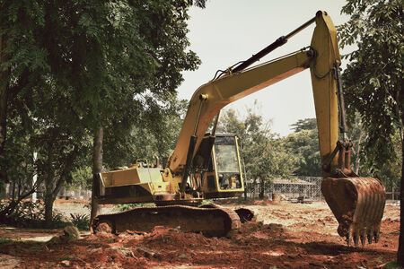 earth moving: Truck backhoe with trees. Stock Photo