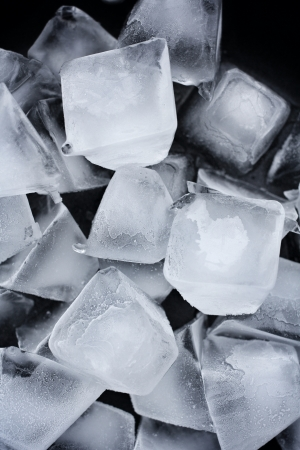 ice cubes on black background photo