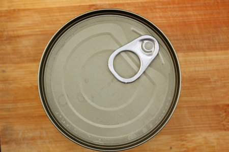 Tin can on wood background photo