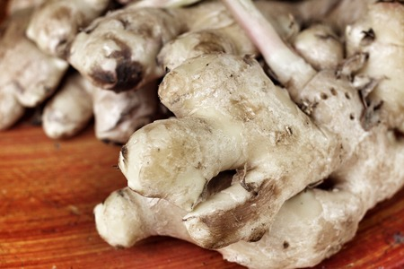 Ginger root on wooden table photo