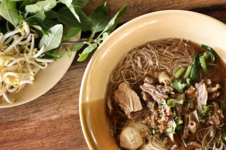 Beef noodles in soup asian style photo