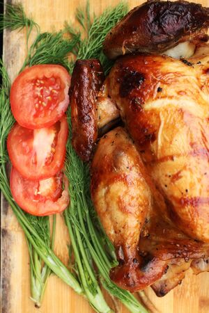 Whole roasted chicken with fresh vegetables for thanksgiving day photo