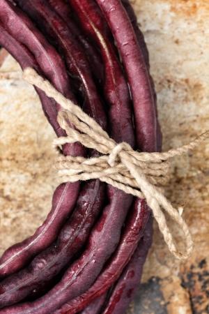long bean: Purple yard long bean  on brown background