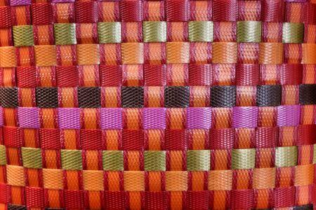 interlace: textured surface of  orange nylon strings