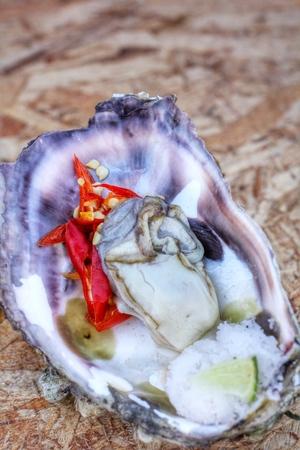 fresh raw oysters chilli and lemon photo