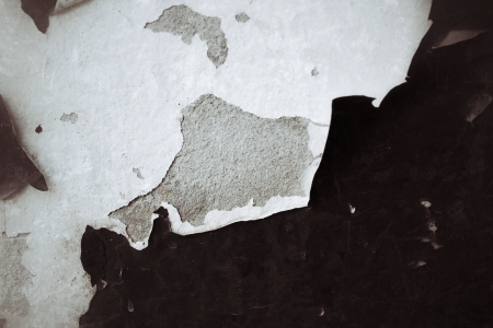 wall with peeling plaster brown color. photo
