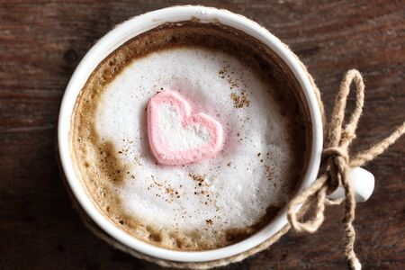 Hot chocolate with heart pink marshmallow for valentines day photo