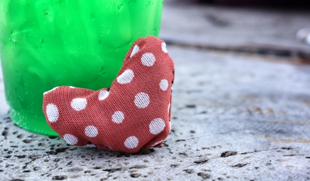 Green drinks and red fabric heart for valentines day photo