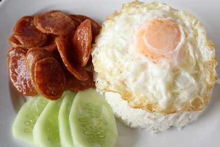 fried egg  chinese sausage and rice photo