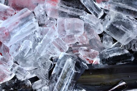 Bottles of red wine on ice photo
