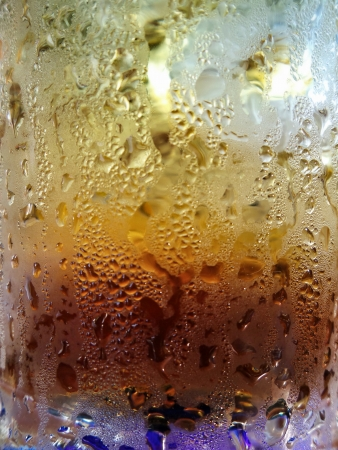 close up of cola with ice cubes