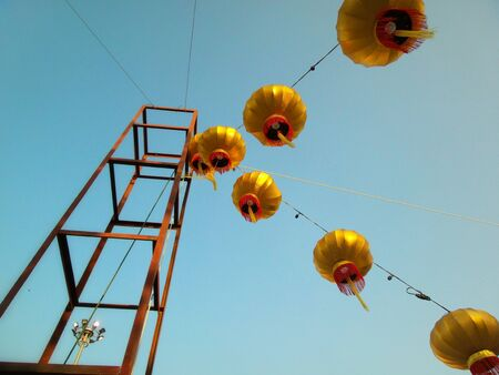 gold chinese lanterns during new year festival photo