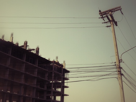 unfinished building: Crane and unfinished building at construction site