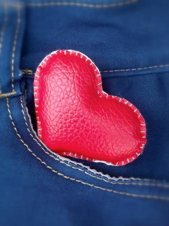 leather red heart in jeans pocket photo