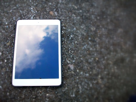 Tablet  touch with blue sky on black background Stock Photo - 25707941