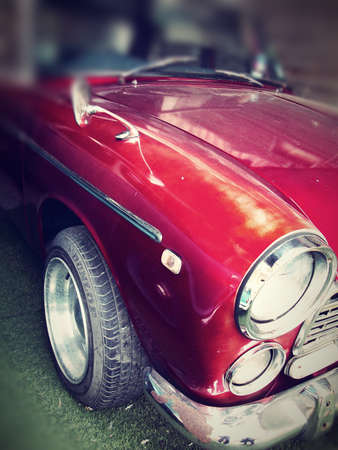 Mirror on an vintage classic car - red color photo