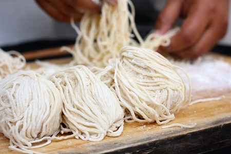 Chef making egg noodle