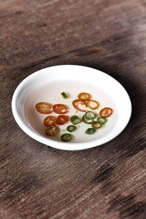 acetic: Vinegar with chili in a bowl