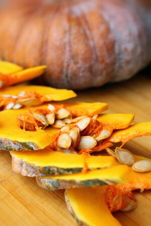 Slices of fresh pumpkins - ripe cut pumpkins photo