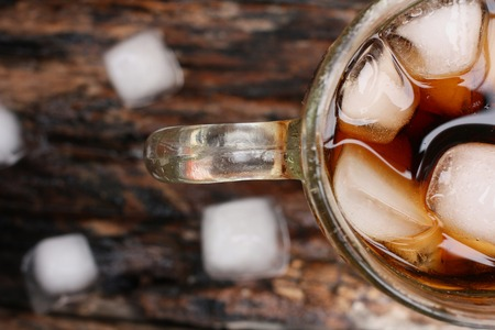 Glass of cola with ice cubes photo