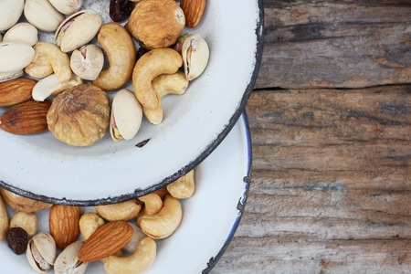 Mix of tasty nuts - almond, fig, raisin, cashew, macadamia and  pecan photo